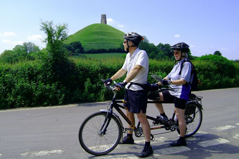 Cyclists and Glastonbury Tor