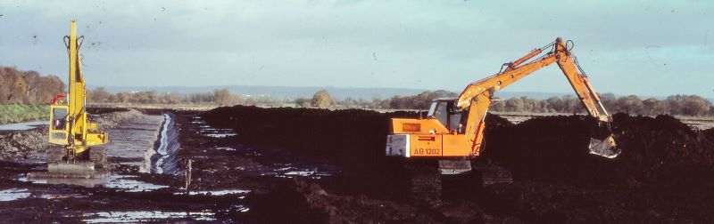 Excavators digging peat