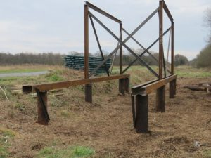Piles and steelwork tower hide